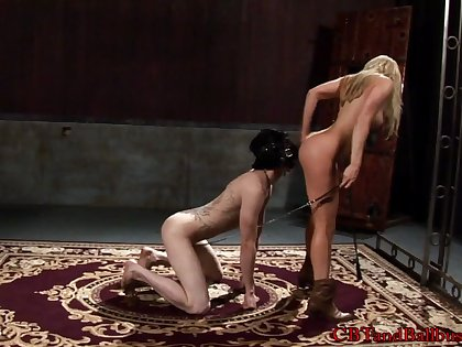 Beautiful blonde babe with natural tits in a steamy BDSM scene