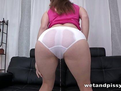 Sex-mad bitch relieves say no to bladder by peeing all over herself on an obstacle couch