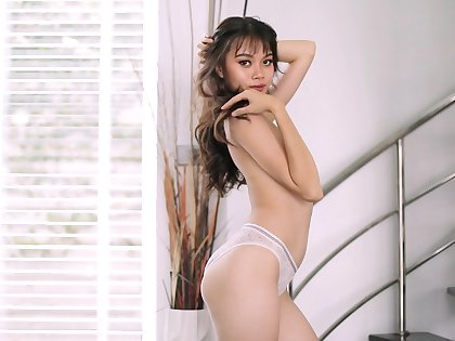 Asian model Sowan flashes the brush perky tits and pink fancy tube