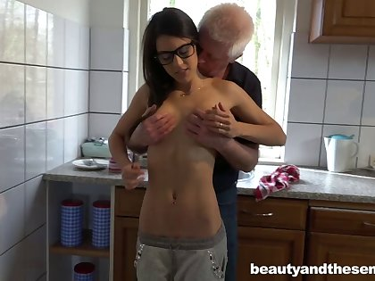 Skinny slut Carolina with glasses having coitus with an old man