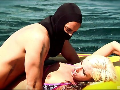Hardcore fucking on the raft between a masked guy and a sexy blonde