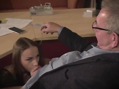 Staggering brunette with glasses is having a ffm threesome at work and enjoying it a lot